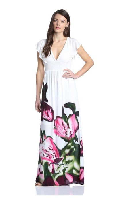 Robe longue desigual solde blanche avec fleur sur le bas de la jupe