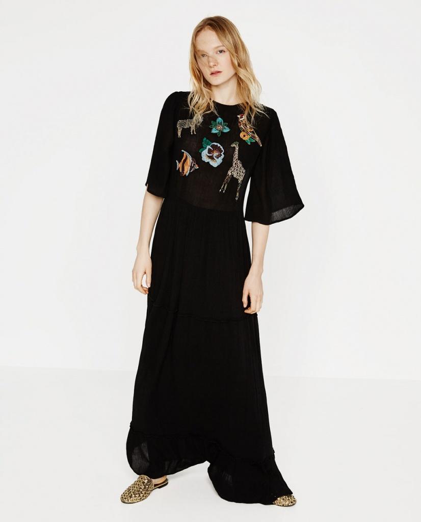 Belle robe noire originale avec animaux et dos tulle tout en transparence