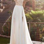 Magnifique robe longue blanche mousseline et dentelle originale tres largement fendue