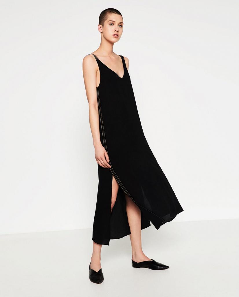 Robe noire fluide decollete fendue de chaque cote dessus genoux