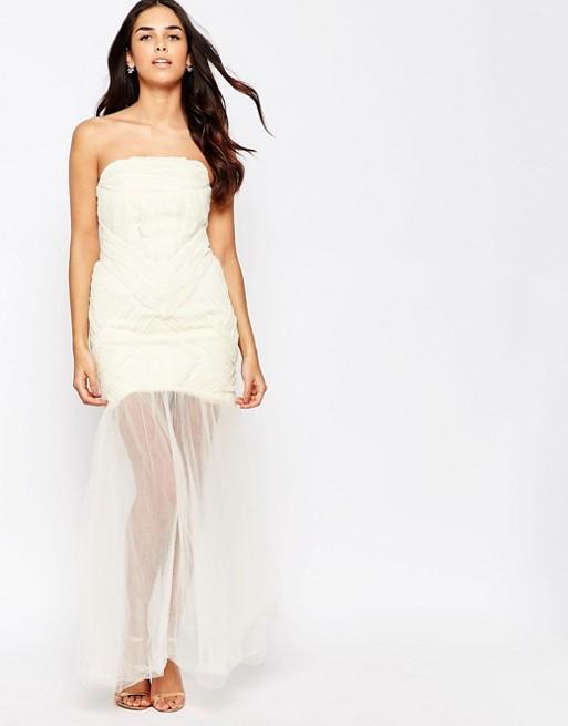 Robe blanche jupe superposee en mousseline bustier