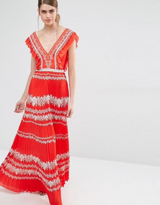 Robe originale rouge en mousseline avec imprime fleur