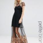 Belle robe originale transparence de voile et motif beige longue noire