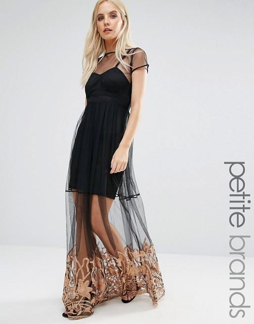 81742363df7 Belle robe originale transparence de voile et motif beige longue noire