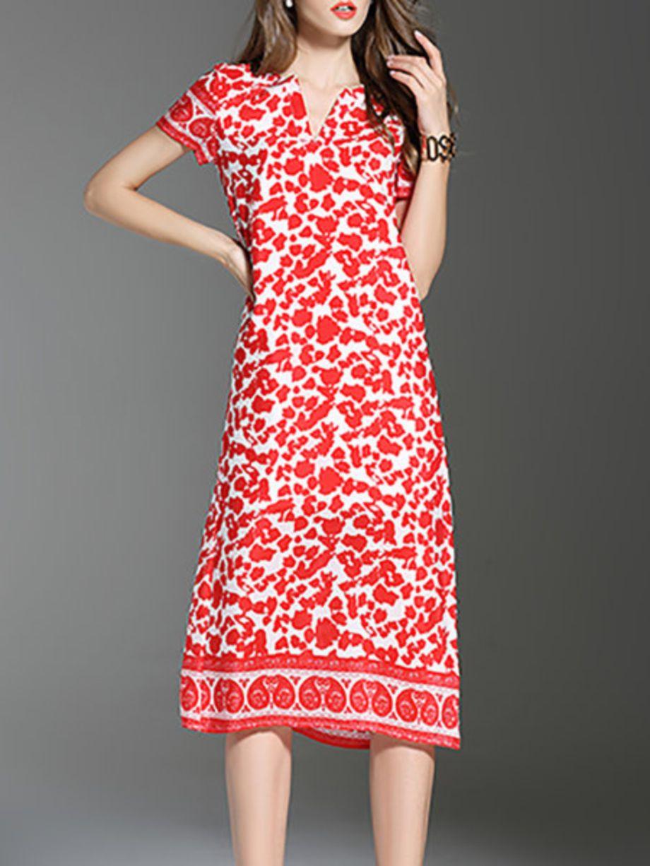 Robe beau motif rouge et blanc manche courte mi longue