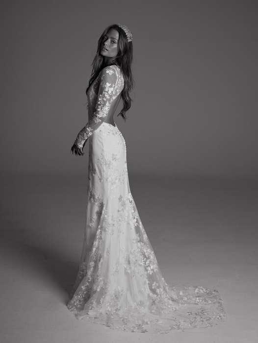 Magnifique robe longue dentelle mariage blanche manches longues dentelle