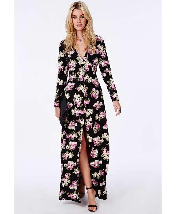 Robe longue fleurie sur fond noir a manche longue fendue niveau genou