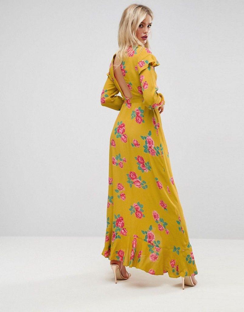 Robe longue fond jaune moutarde motif fleuri sur manche longue